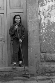 Girl in Doorway with Broom (Cusco, Peru 1998)