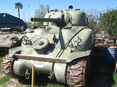army(0.0), armored car(1.0), combat vehicle(1.0), military vehicle(1.0), weapon(1.0), vehicle(1.0), tank(1.0), self-propelled artillery(1.0), gun turret(1.0), cannon(1.0), military(1.0),
