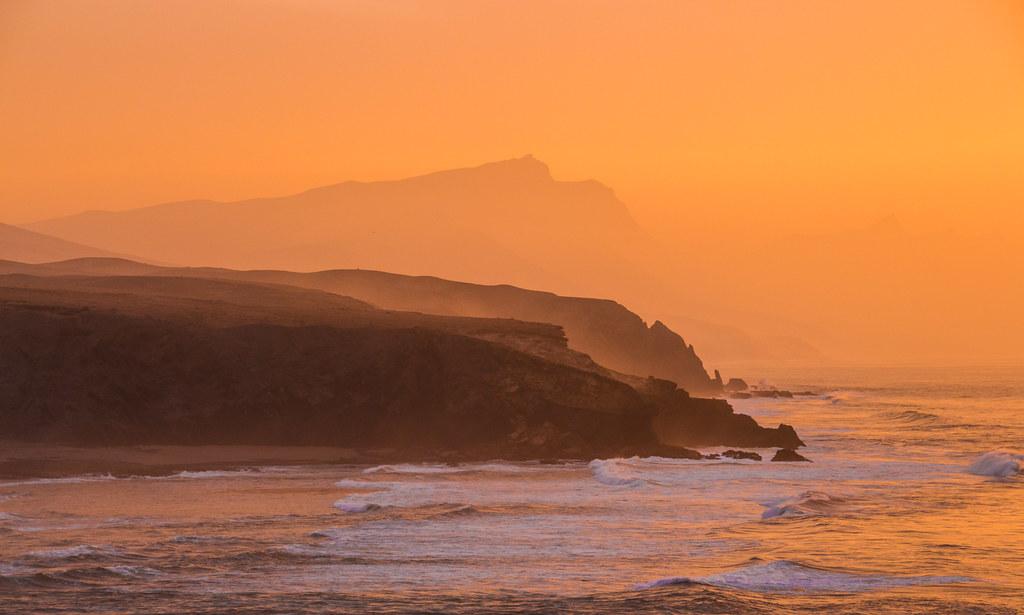 misty sunset cliff