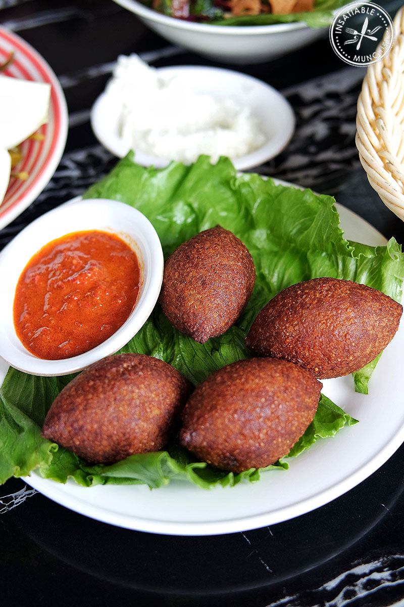 Fried Kibbeh: Seasoned lamb mince enclosed in burghul, shaped into an oval, and fried to a crisp.