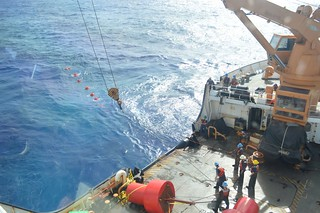 Crew members on the Coast Guard Cutter Sequoia and scientists with the National Oceanic and Atmospheric Administration deploy a hydrophone in Challenger Deep near the Federated States of Micronesia, Jan. 17, 2015. The crew of the Sequoia and NOAA scientists deployed the hydrophone in an attempt to listen to ambient sound in the deepest part of the Challenger Deep. (U.S. Coast Guard phot