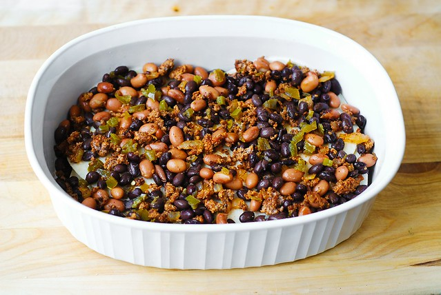 Top tortillas with meat mixture with pinto beans and black beans