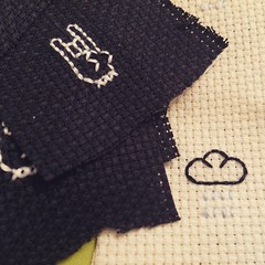 Stitching up a batch of badges for market next month #crossstitch #devilhorns #rainclouds #666