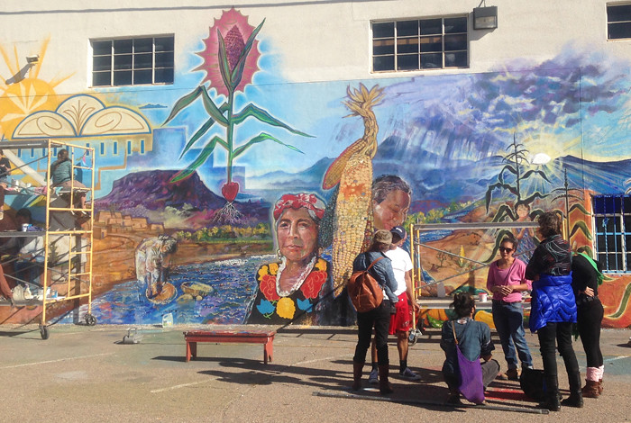 A new community mural on the Hunter Ford facility in Española celebrates the building's planned revitalization and the future location of the Northern New Mexico Food Hub.