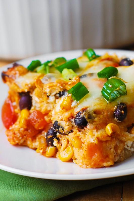 enchiladas with black beans, corn, red bell pepper, green bell pepper and corn tortillas
