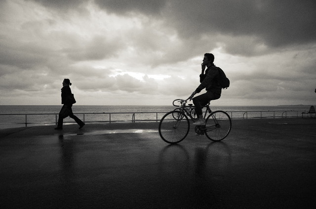 The young woman and the cyclist (French Riviera).