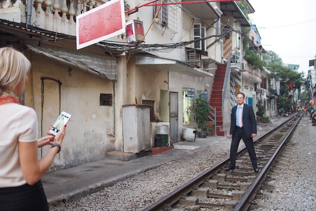 business tourists and a train track. Hanoi, Vietnam