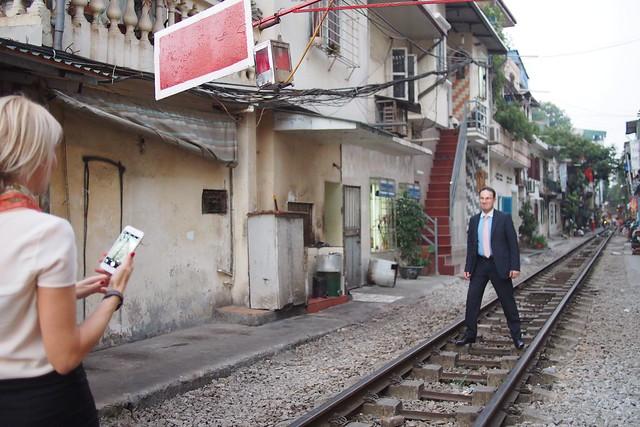 business tourists and a train track. Hanoi, Vietnam