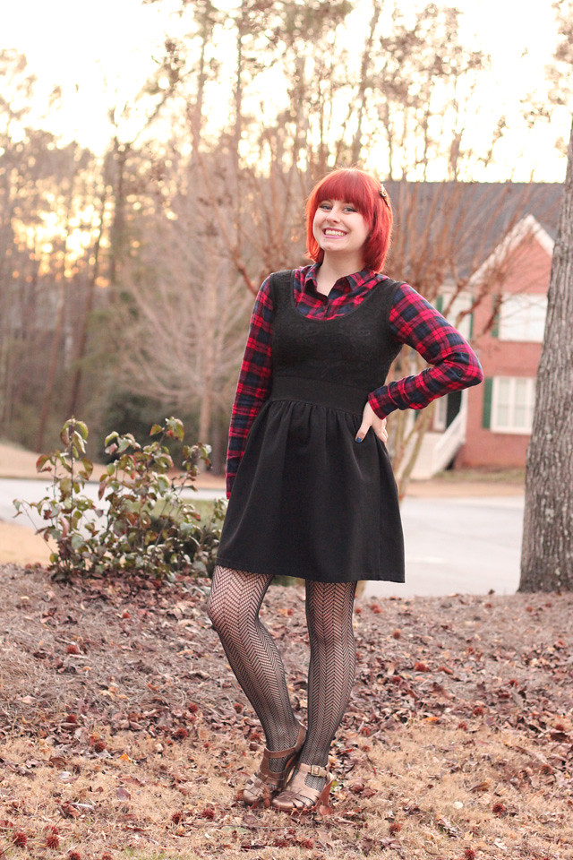 Plaid Button Down under a Black Dress, Fishnet Tights, and Bronze Shoes