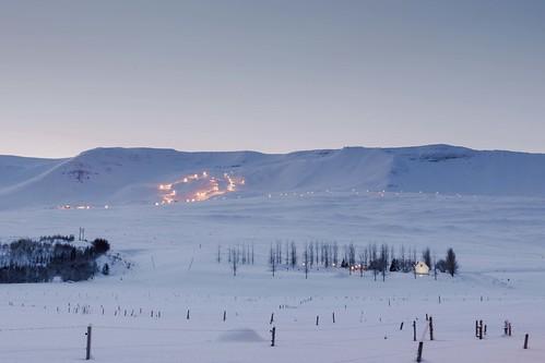 winter sunset sky snow mountains ice iceland ísland eyjafjordur lögmannshlíðarkirkja einarschioth