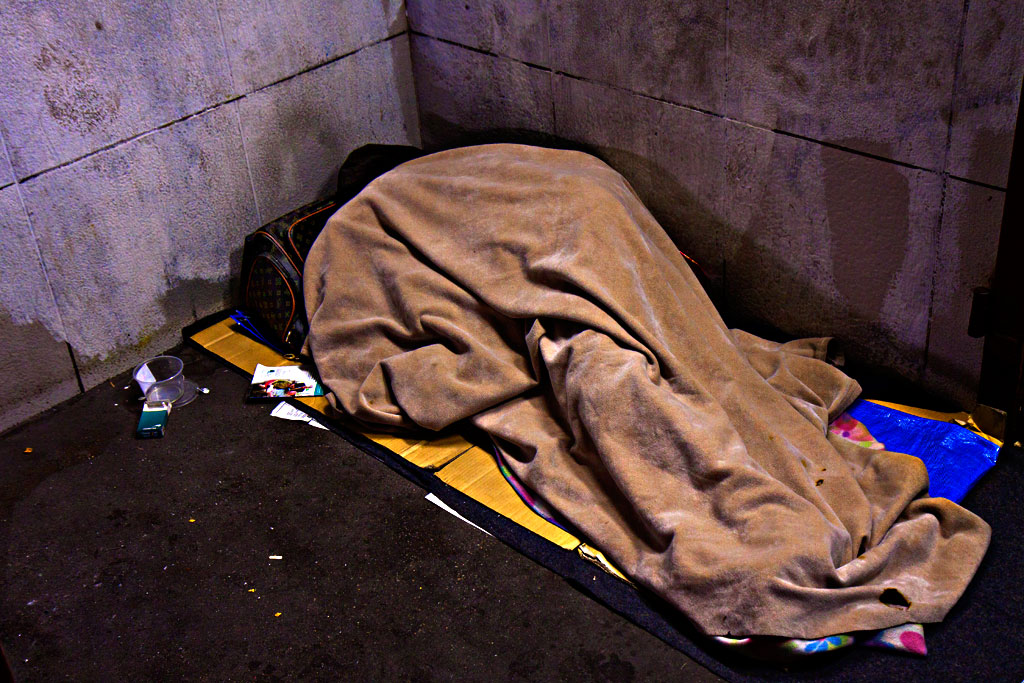 Person-sleeping-in-subway-entrance-on-12-14-14--Center-City
