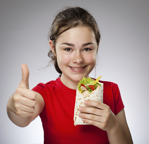 Girl holding sandwiches