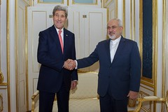 U.S. Secretary of State John Kerry shakes hands with Foreign Minister Javad Zarif of Iran in Vienna, Austria, on November 23, 2014, before the two begin a one-on-one meeting amid broader negotiations about the future of Iran's nuclear program. [State Department photo/ Public Domain]