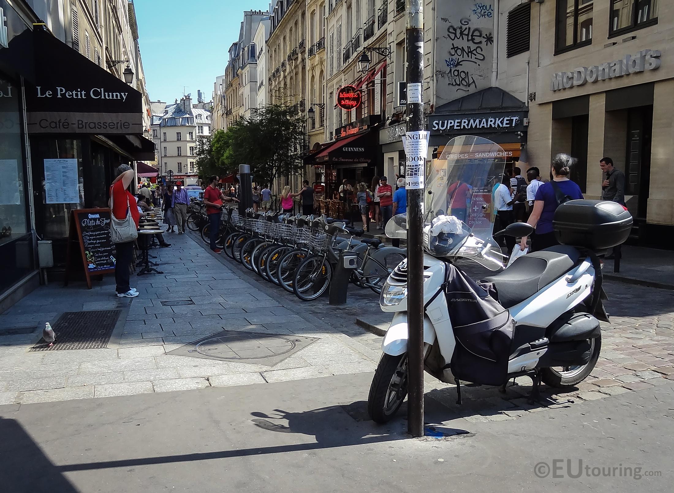 Row of Velib bikes between shops