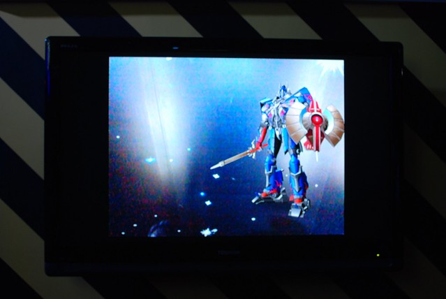 Augmented Reality Display where the Transformers will transform when shown an autobots shield and fight when shown a decepticon shield.