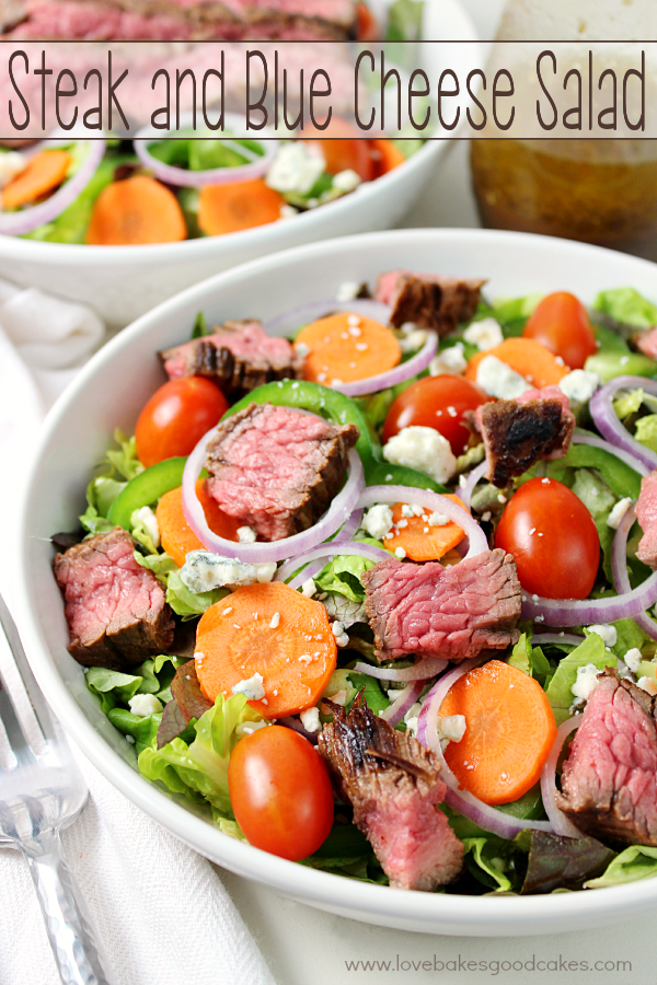 Steak and Blue Cheese Salad in a bowl with a fork.