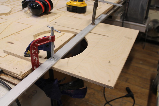 Straight edge clamped in place