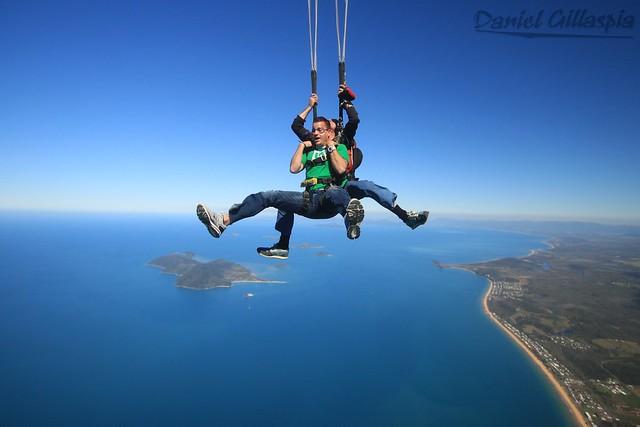 Tandem skydiving deployed parachute over ocean