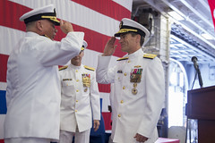 Rear Adm. John B. Nowell turns over command of Amphibious Force 7th Fleet to Rear Adm. Marc H. Dalton. (U.S. Navy/MC3 William Sykes)