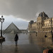 Tourist braving the rain for a photo op at the Louvre by lady_xoc