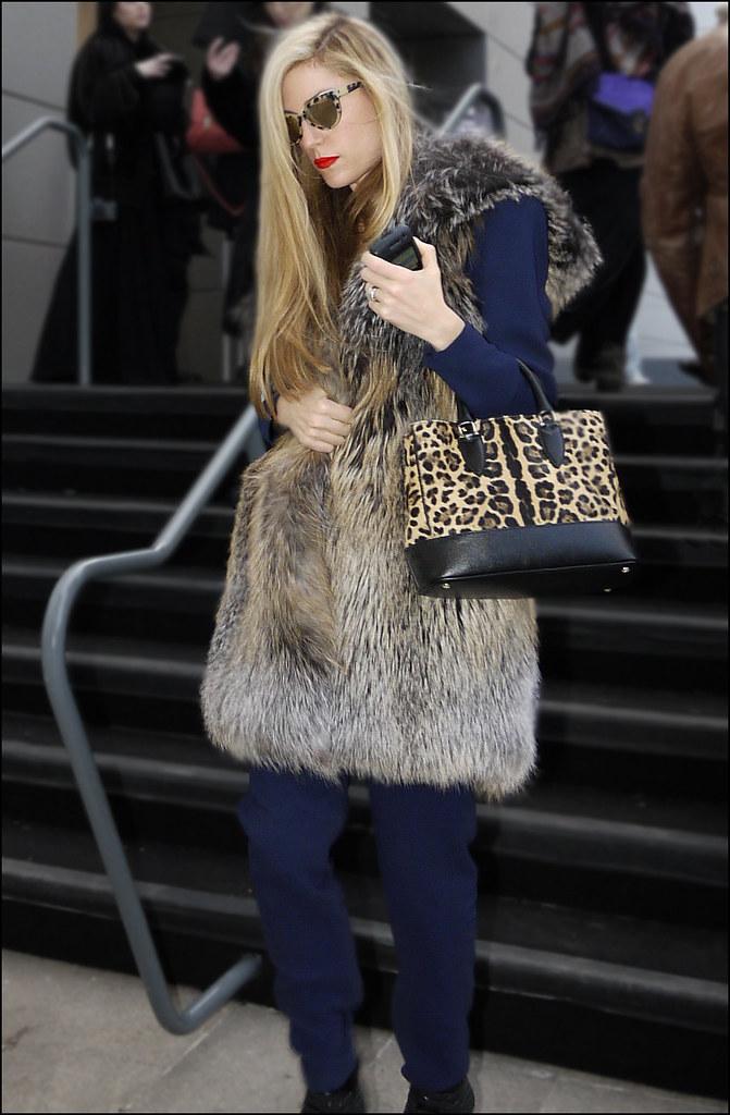 SS1-15  11w Joanna Hillman long fur vest over blue top and pants leopard print bag red lip sunglasses