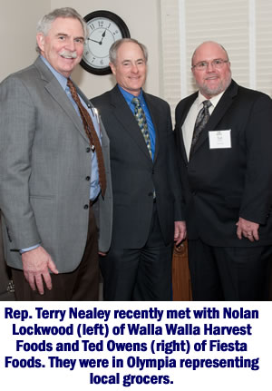 Rep. Terry Nealey with local grocers