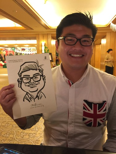 Caricature live sketching for Ritz Carlton Christmas Fiesta 2014