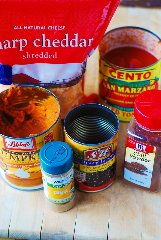 Pumpkin and beef chili ingredients, canned peeled tomatoes, sharp cheddar shredded cheese, canned pumpkin, canned black beans, chili powder, cumin powder