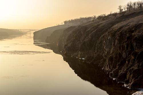 morning bridge winter ice sunrise reflections river ukraine dnepr dnipro zaporozhye