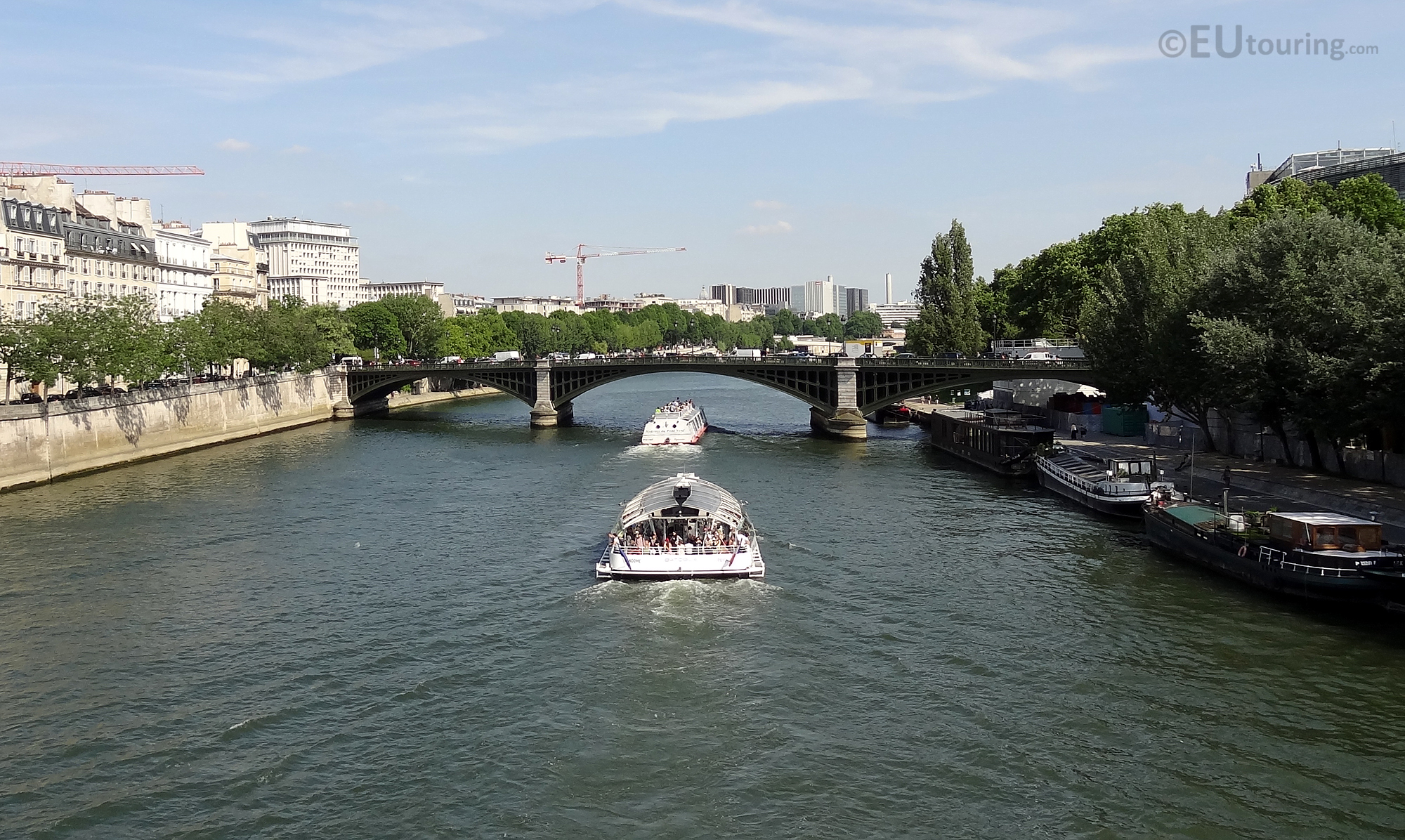 Tour boats going beneath the Pont de Sully