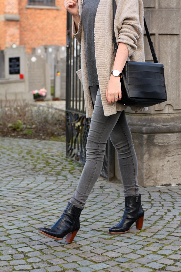 outfit: grey skinny jeans, zinda ankle boots, and other stories handbag
