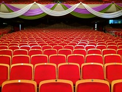function hall(0.0), ballroom(0.0), stage(0.0), banquet(0.0), theatre(1.0), auditorium(1.0), conference hall(1.0), convention center(1.0),