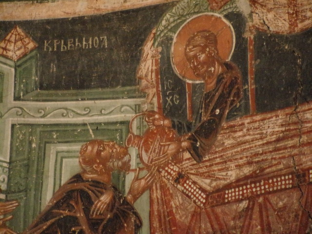 Apostle drinking Eucharist wine, 14th century choir fresco, Pavlica Monastery
