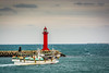 Fishing Vessel and the lighthouse