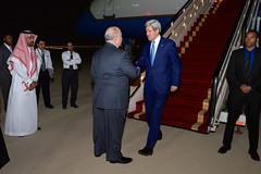 U.S. Ambassador to Saudi Arabia Joseph Westphal welcomes U.S. Secretary of State John Kerry as he arrives in Riyadh, Saudi Arabia, in the early morning hours of March 5, 2015, for meetings with King Salman, Deputy Crown Prince Muhammed bin Nayef, Foreign Minister Saud al-Faisal, and members of the Gulf Cooperation Council. [State Department photo/ Public Domain]