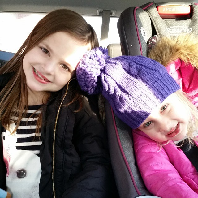 In the car, waiting for Dylan's chorus practice to end. They're entertaining themselves with lipstick and gum. #girls #sisters