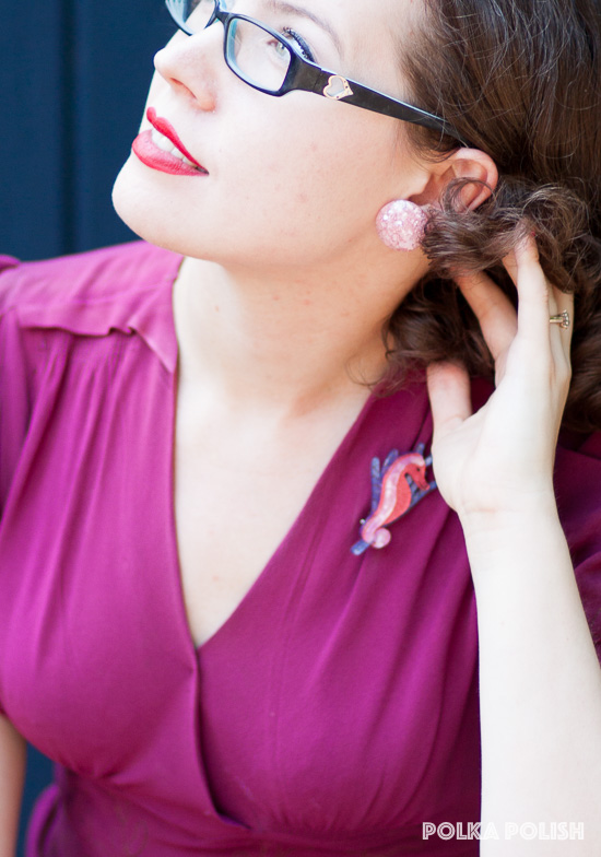 Pink confetti lucite earrings perfectly match the Erstwilder seahorse brooch against a hot pink vintage dress