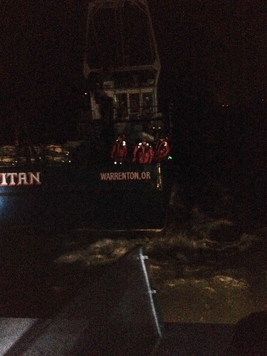 Fishermen aboard the fishing vessel Titan prepare to abandon ship after their vessel grounded on a jetty and began to sink on the Columbia River, off of Ilwaco, Wash., Dec. 5, 2014. The Titan eventually sank at the location and the owner has contracted a company to clean up any pollution and to salvage the vessel. (U.S. Coast Guard photo by Chief Petty Officer Jeremiah Wolf)