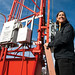 Los Alamos National Laboratory meteorologist and honoree Jean Dewart fostered behavioral changes across the Laboratory, supporting Earth Day and enduring practices of site sustainability, worker lifestyle changes, reduction in electrical and heating use and green transportation initiatives. Shown here with one of the LANL meteorological towers.