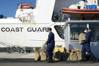 Crewmembers from the Coast Guard Cutter Decisive offload approximately $44 million worth of cocaine at Coast Guard Sector St. Petersburg, Florida, Dec. 16, 2014. On Nov. 29, Decisive crewmembers interdicted a 170-foot bulk freighter motor vessel while on patrol in support of Operation Martillo. (U.S. Coast Guard photo by Ashley J. Johnson)