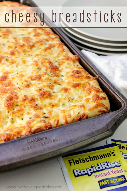 Cheesy Bread sticks in a baking pan.