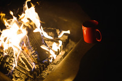 Red Coffee Cup by the Fire