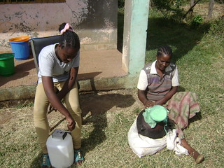 Debritu and Jigi churning milk by the two types of churners_Ejere (Phtoe:ILRI\Solomon Gizaw)