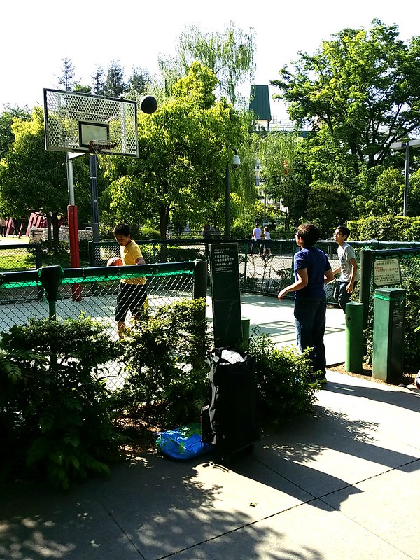Boys playing basketball in Tokyo