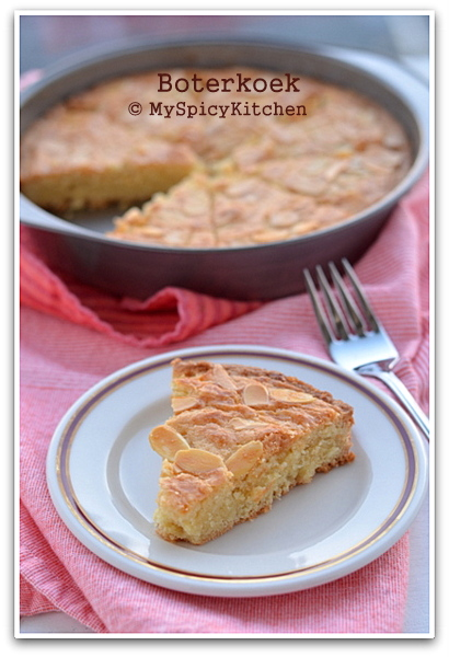 Slice of Dutch Butter Cake in a plate and cake in a pan in the background