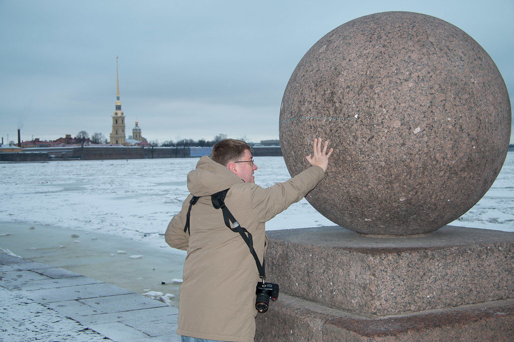 Ken tries to push huge stone ball into Neva River
