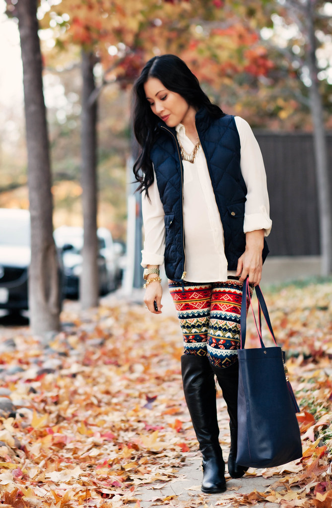 cute & little blog | petite fashion #maternity #bumpstyle #thirdtrimester | white blouse, navy quilted puffer vest, white plum tribal print leggings, otk boots | fall winter outfit