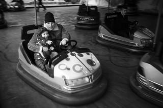 Father and son having fun at St. Mathew's Fair in Prague - Matějská pouť v Praze
