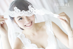 gown(0.0), headpiece(0.0), pink(0.0), petal(0.0), bride(1.0), veil(1.0), bridal clothing(1.0), bridal veil(1.0), clothing(1.0), woman(1.0), wedding dress(1.0), dress(1.0),