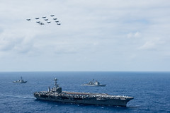 Aircraft assigned to Carrier Air Wing (CVW) 9 fly in formation over USS John C. Stennis (CVN 74), USS William P. Lawrence (DDG 110), left, and USS Mobile Bay (CG 53) during an air and sea power demonstration before returning to San Diego. (U.S. Navy/MC1 Bryan Niegel)